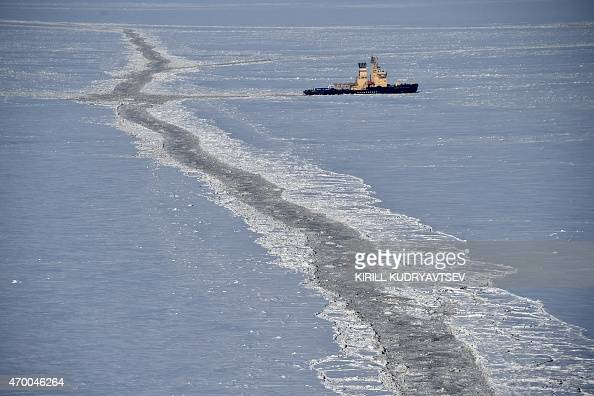 A picture taken on April 16 2015 shows an icebreaker in the Kara Sea The Yamal LNG project aiming to extract and liquefy gas from the...