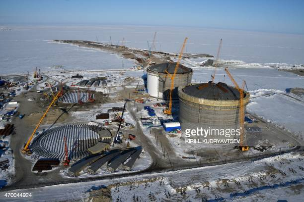 A picture taken on April 16 2015 shows natural gas reservoirs under construction at the port of Sabetta in the Kara Sea shore line on the Yamal...