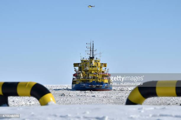 A picture taken on April 16 2015 shows the icebreaker Tor at the port of Sabetta in the Kara Sea shore line on the Yamal Peninsula in the Arctic...