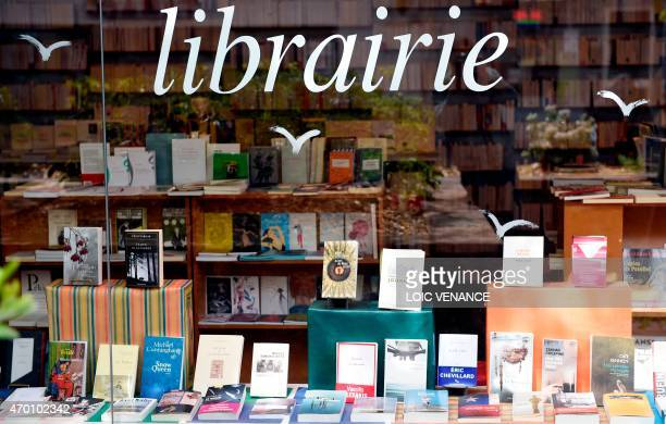A picture taken on April 17 2015 in Paris shows the window display of a bookstore AFP PHOTO / LOIC VENANCE