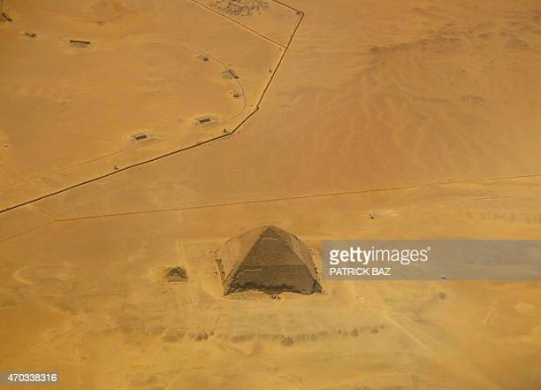 A picture taken on April 19 2015 shows an aerial view of the bent pyramid of Dahshur a royal necropolis located in the desert on the west bank of the...
