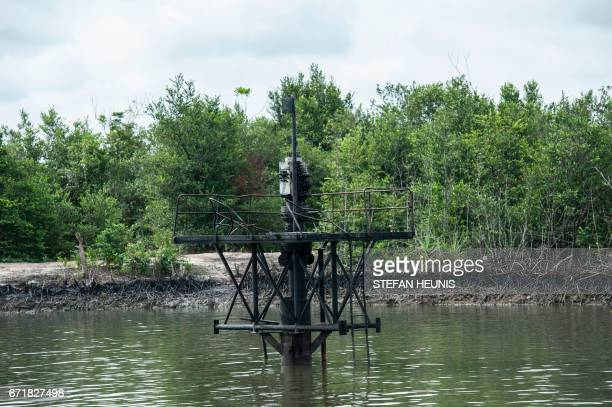 A picture taken on April 19 2017 shows an abandoned wellhead of loading pump station in the Niger Delta region near the city of Warri NNS Pathfinder...