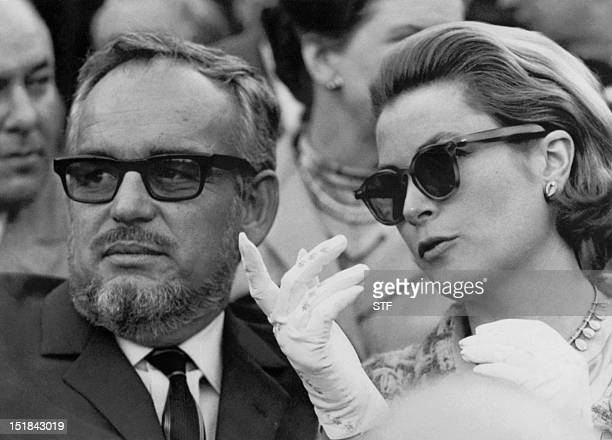 A picture taken on April 19 in Sevilla shows Princess Grace of Monaco speaking with her husband Prince Rainier during a bullfight in Seville Grace...