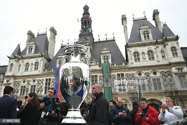 A picture taken on April 2 2016 shows the trophy of the UEFA Euro 2016 football tournament in front of the city hall of Paris during the first stage...
