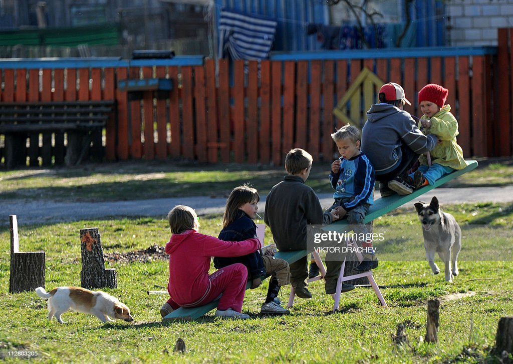 A picture taken on April 20, 2011 shows children playing on seesaw in the village of Strelichevo, some 370 km southeast of Minsk. One fifth of Belarus' agricultural land was contaminated following the blast at the nuclear reactor in the Ukraine and around 70% of the fallout fell in Belarus. April 26 marks the 25th anniversary of the Chernobyl nuclear disaster.