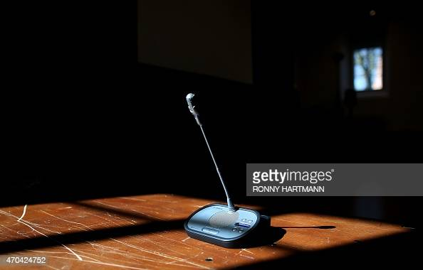 Picture taken on April 20 2015 shows a microphone standing in the courtroom at the 'Ritterakademie' venue in Lueneburg northern Germany The...