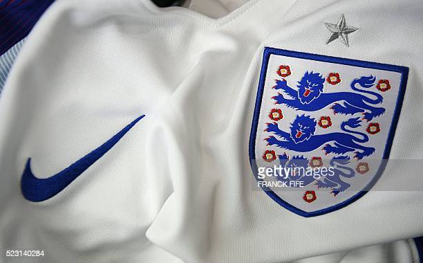 A picture taken on April 21 2016 in Paris shows the jersey of the English national football team for the UEFA Euro 2016 European football...