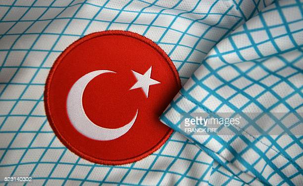 A picture taken on April 21 2016 in Paris shows the jersey of the Turkish national football team for the UEFA Euro 2016 European football...