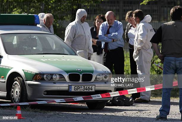 FILES A picture taken on April 25 2007 shows policemen standing next to the body of a colleague shot down in Heilbronn southern Germany German police...