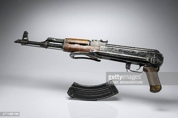 A picture taken on April 26 2015 in Paris shows a kalashnikov AK47 gun AFP PHOTO / LIONEL BONAVENTURE