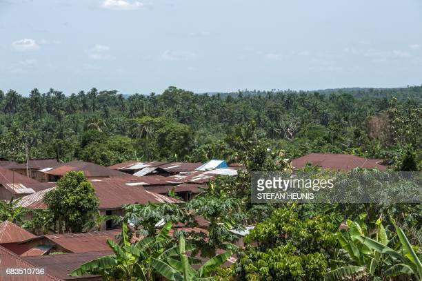 A picture taken on April 26 2017 shows roofs of the houses of the Obung community though which the Cross River Super Highway will run in Calabar The...