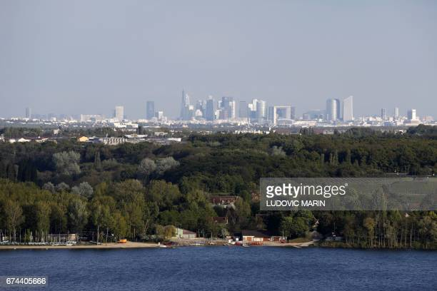 A picture taken on April 27 2017 from a station of the 'Axe majeur' in Cergy Pontoise outside Paris shows a view of skyscrapers in the business...