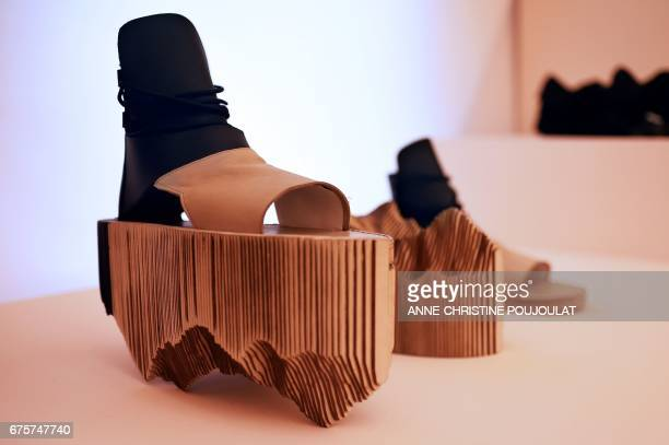 A picture taken on April 28 2017 shows shoes created by Switzerland accessories designer Marina Chedel presented at the exhibition of the fashion...