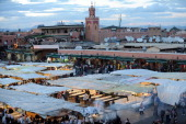 A picture taken on April 29 2011 shows tourists walking in a market at Djemaa ElFna square in Marrakech a day after a bomb killed 16 people at the...