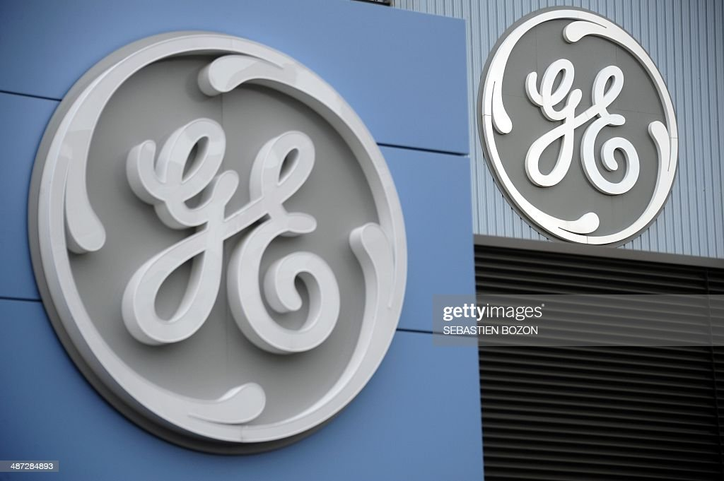 A picture taken on April 29, 2014 in Belfort shows the logo of US giant General Electric. The battle for Alstom was set to intensify today, with Siemens ready to confirm its bid for the French engineering group also coveted by US rival General Electric, an informed source said. AFP PHOTO / SEBASTIEN BOZON
