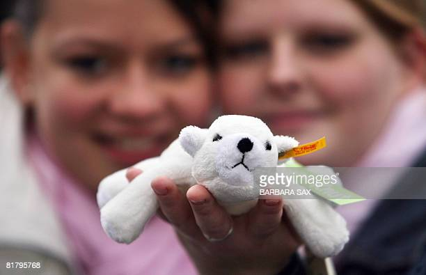 FILES Picture taken on April 3 2007 shows Kerrin and Christina from Neumuenster northern Germany holding a cuddly toy version part of the special...