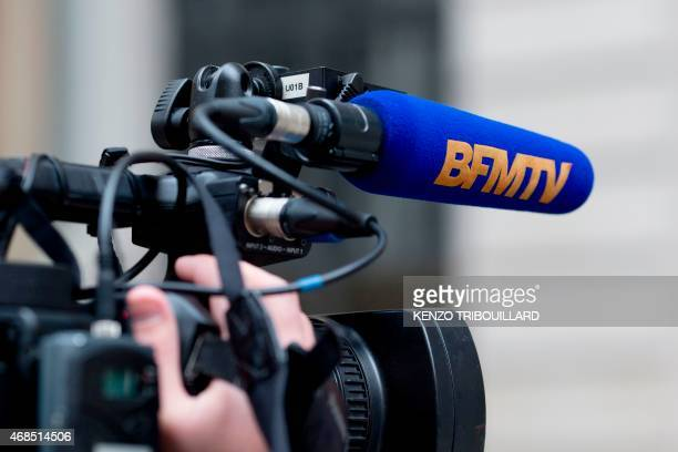 A picture taken on April 3 2015 shows a camera bearing the French television channel 'BFMTV' logo in Paris AFP PHOTO KENZO TRIBOUILLARD / AFP PHOTO /...