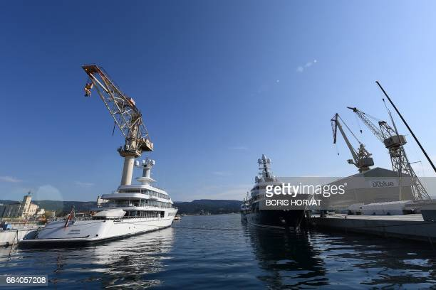 A picture taken on April 3 2017 shows megayachts mooring outside the 'Grande Forme' a 200mx60m drydock to refit and repair megayachts during its...