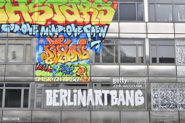 Picture taken on April 3 2017 shows the facade of The Haus an old bank building housing an urban art project in Berlin In Berlin arguably Europe's...