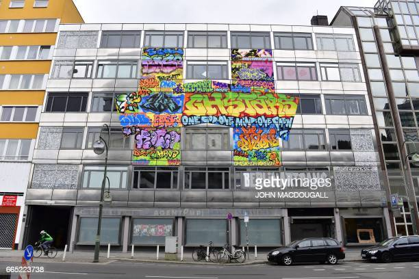 Picture taken on April 3 2017 shows The Haus an old bank building housing an urban art project in Berlin In Berlin arguably Europe's urban art...