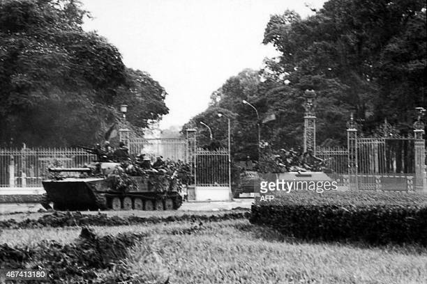 A picture taken on April 30 1975 in Saigon shows tanks of the North Vietnamese Army forces rolling through the gates of the South Vietnamese...