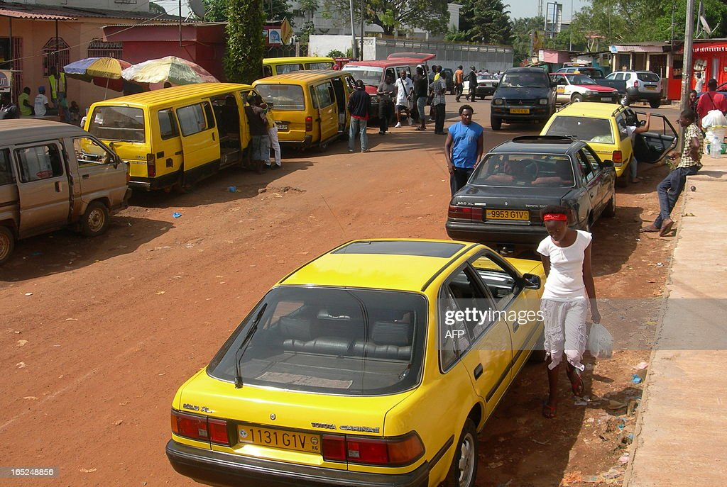 A picture taken on April 30 2011 shows a yellowpainted taxi in a street of Libreville AFP PHOTO / PATRICK FORT