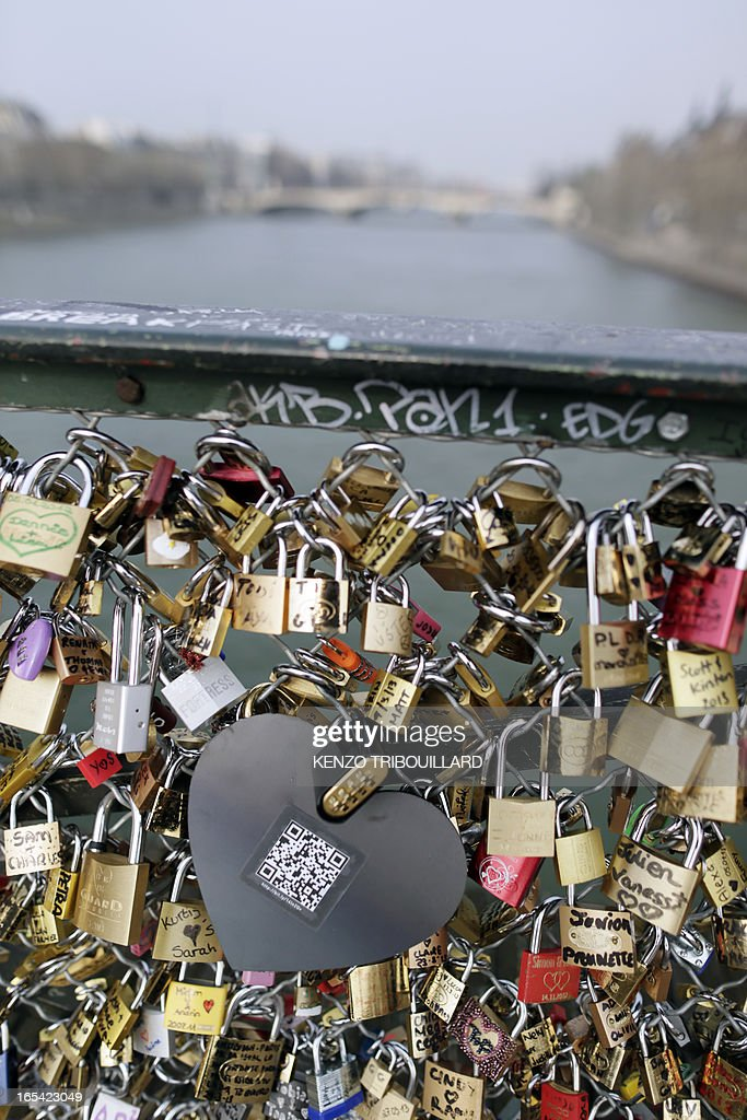 A picture taken on April 4, 2013 at the'Pont des Arts' in Paris shows one of the black heart-shaped padlocks symbolizing abused women which the French feminist movement 'Ni Putes, Ni Soumises' (Neither Whores Nor Submissive - NPNS) founded in 2002 asked individuals to place on the bridge to mark its tenth anniversary.