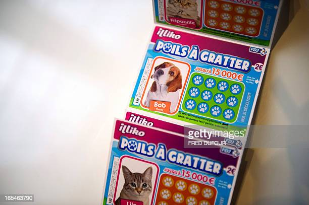 Picture taken on April 4 2013 in Paris shows tickets of 'Poils a gratter' the new scratchcard game of the Francaise des Jeux the operator of France's...