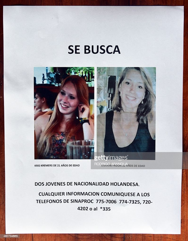 Picture taken on April 4, 2013 of a poster handed by the Dutch embassy in Panama City, showing images of Dutch Kris Kremers (L), 21, and Lisanne Froon, 22, who where last seen in Boquete, Province of Bocas del Toro 500 km northwest of the Panamania capital on March 31. AFP PHOTO / Rodrigo ARANGUA