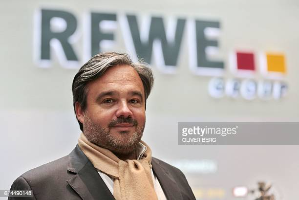Picture taken on April 4 2016 in Cologne shows Alain Caparros chairman of the retail chain Rewe After negociation talks between the Tengelmann group...