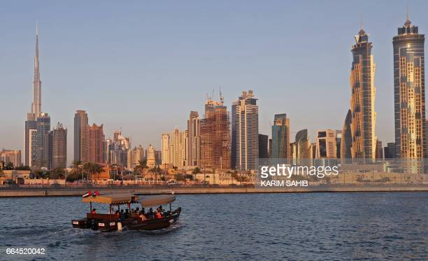 A picture taken on April 4 shows Dubai's skyline dominating the water canal which links the city's business hub to the Gulf / AFP PHOTO / KARIM SAHIB