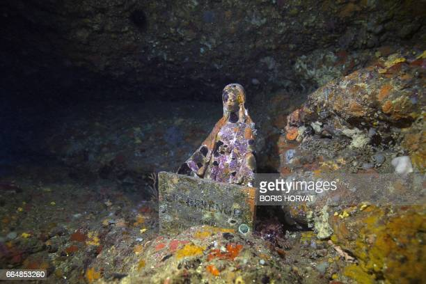 A picture taken on April 5 2017 in the sea off La Ciotat southern France shows a Virgin Mary statue known as 'Gaby's Virgin' A Virgin Mary statue...