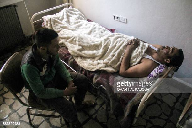 A picture taken on April 6 2017 shows 40yearold Hassan Youssef a victim of the April 4 2017 suspected toxic gas attack in Khan Sheikhun receiving...