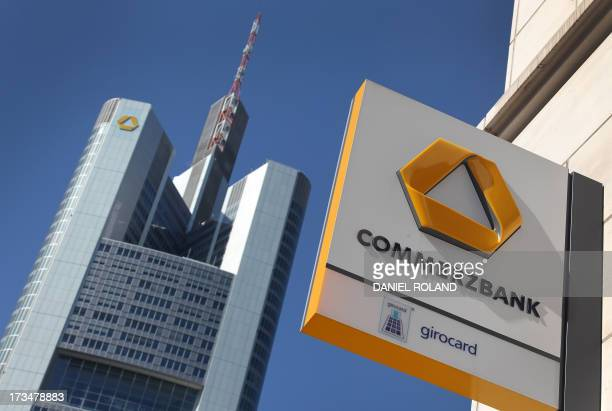 A picture taken on April 7 2011 shows the logo of the German bank Commerzbank on a branch and the headquarters of the bank in Frankfurt/M western...