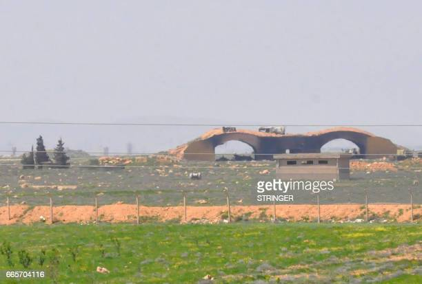 A picture taken on April 7 2017 shows a view of the damaged Shayrat airfield at the Syrian government forces military base targeted earlier overnight...