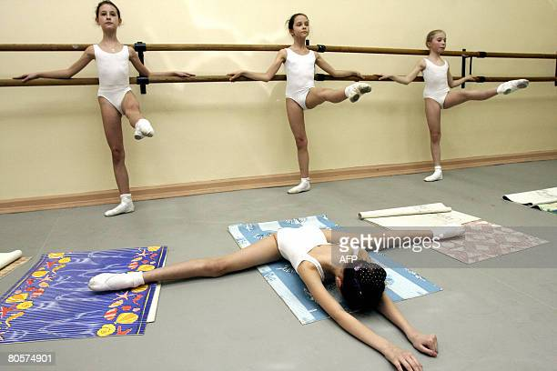 Picture taken on April 8 2008 shows tenyearold Russian wouldbe ballerina's performing warm up exercises at the Vaganova Ballet Academy in St...