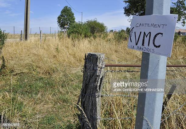 A picture taken on August 1 2015 in Bure eastern France shows a sign indicating the direction of the 'VMC camp' which will take place from August 1...