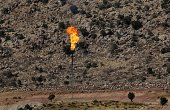 A picture taken on August 10 2014 shows a chimney at an oil field in Sheikhan northeast of the city of Mosul in northern Iraq and near the Kurdish...