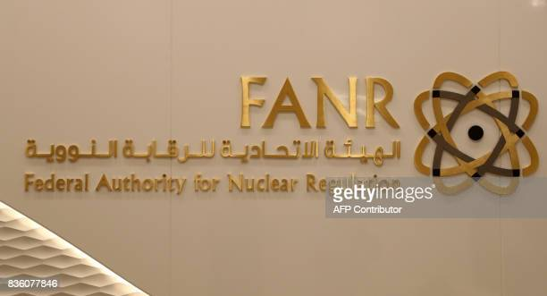 A picture taken on August 10 2017 shows the sign and logo of the UAE's Federal Authority for Nuclear Regulation at its premises in the capital Abu...