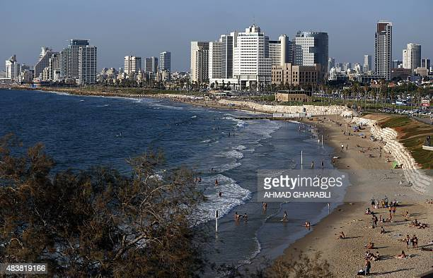 A picture taken on August 13 2015 shows a general view of a beach in the Israeli city of Tel Aviv AFP PHOTO / AHMAD GHARABLI
