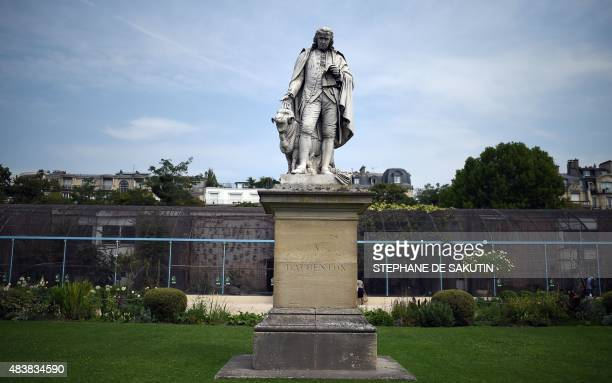A picture taken on August 13 2015 shows the statue of French naturist Louis JeanMarie Daubenton in front of the aviary at the Jardin d'Acclimatation...