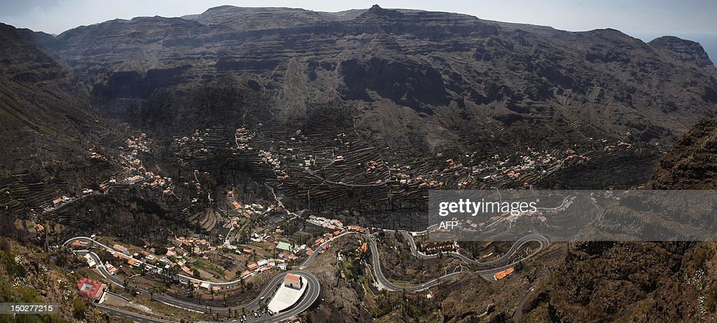 A picture taken on August 14, 2012 shows the Valle Gran Rey after it has been devastated by wildfire on the Spanish Canary island of La Gomera. The blaze on the Atlantic island of La Gomera, part of the Canaries, has forced 5,000 people to be evacuated and ravaged more than 4,000 hectares (10,000 acres) of land, including part of a rare nature reserve.