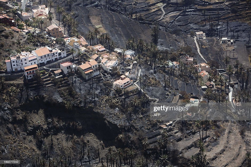 A picture taken on August 14, 2012 shows the Valle Gran Rey after it has been devastated by wildfires, on the Spanish Canary island of La Gomera. The blaze on the Atlantic island of La Gomera, part of the Canaries, has forced 5,000 people to be evacuated and ravaged more than 4,000 hectares (10,000 acres) of land, including part of a rare nature reserve.