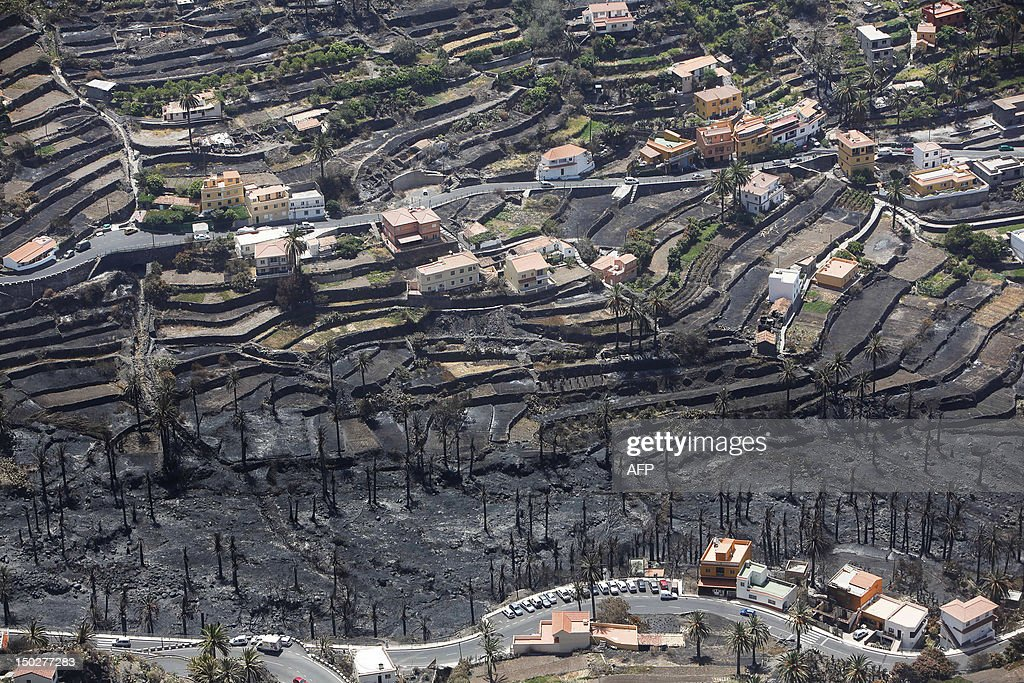 A picture taken on August 14, 2012 shows the Valle Gran Rey after it has been devastated by wildfires, on the Spanish Canary island of La Gomera. The blaze on the Atlantic island of La Gomera, part of the Canaries, has forced 5,000 people to be evacuated and ravaged more than 4,000 hectares (10,000 acres) of land, including part of a rare nature reserve. AFP PHOTO / DESIREE MARTIN