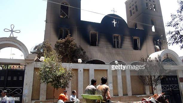 A picture taken on August 14 shows the facade of the Prince Tadros Coptic church after being torched by unknown assailants in the central Egyptian...