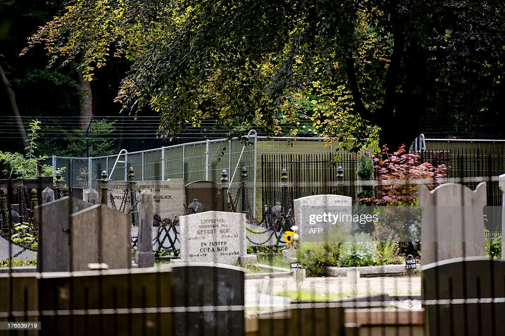 A picture taken on August 15, 2013 shows the cemetery in Lage Vuursche, about 30 kilometres (20 miles) southeast of Amsterdam, during the preparations of Dutch Prince Friso's burial. Prince Friso is to be buried near his mother's castle on August 16, 2013, days after he died from injuries sustained in a 2012 skiing accident, the palace said. King Willem-Alexander's brother Friso died on August 12, 2013, aged 44, around 18 months after after he was left brain-damaged and comatose by an avalanche while skiing in Austria.