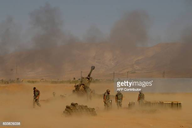 A picture taken on August 17 during a tour guided by the Lebanese army shows soldiers firing towards jihadist militants from recently captured...