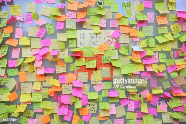 A picture taken on August 18 2017 shows postit notes with messages against the attacks and in tribute to the victims of the Barcelona attack on Las...