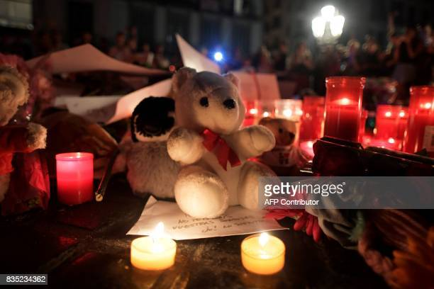 A picture taken on August 18 2017 shows tributes to the victims of the attack of Barcelona set up at the Font de Canaletes in Barcelona as they pay...