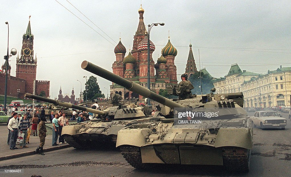 A picture taken on August 19 1991 shows Soviet Army tanks parked near Spassky gate an entrance to the Kremlin and Basil's Cathedral in Moscow's Red...
